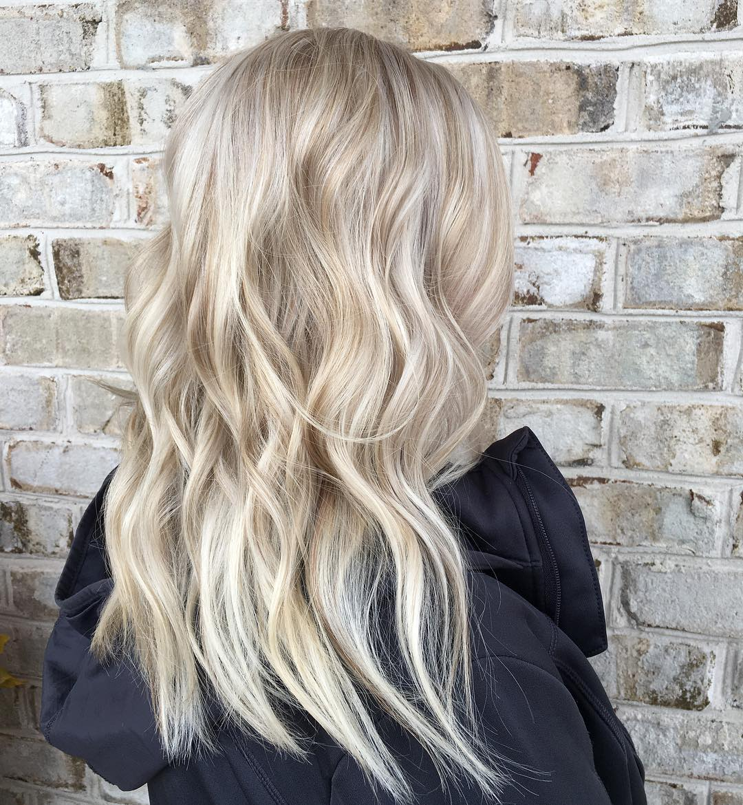 Wavy blonde hair with lowlights