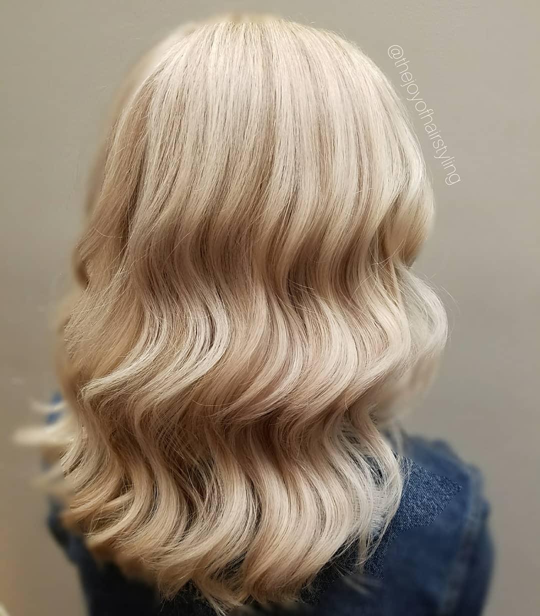 Vanilla blonde hair with lowlights added