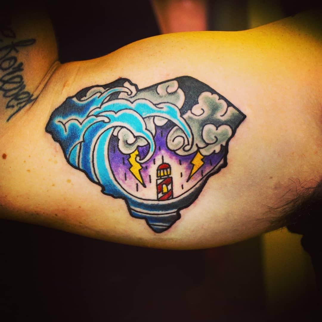 Storm Lighthouse Bicep Tattoo
