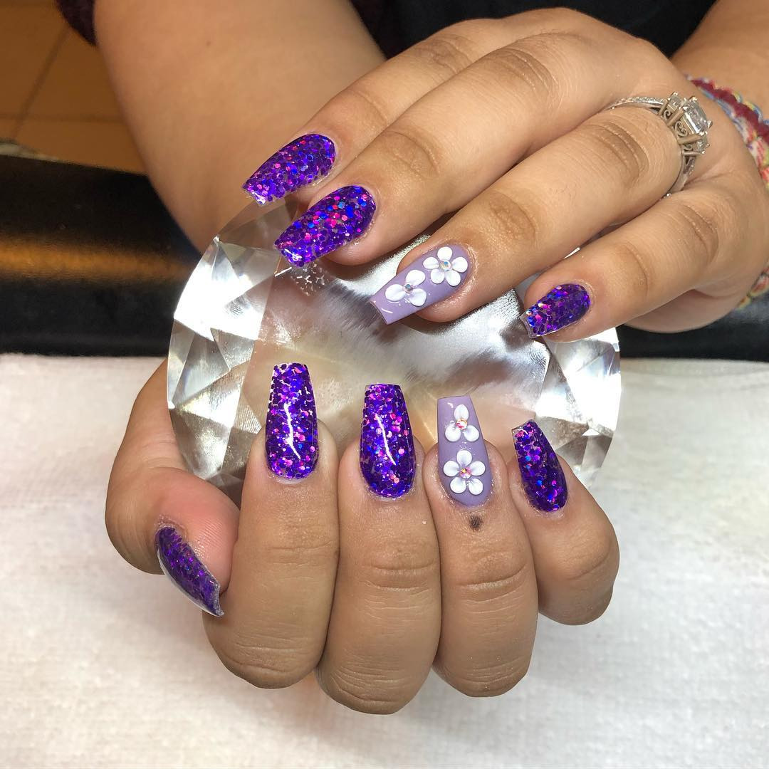Flowers on purple coffin nails