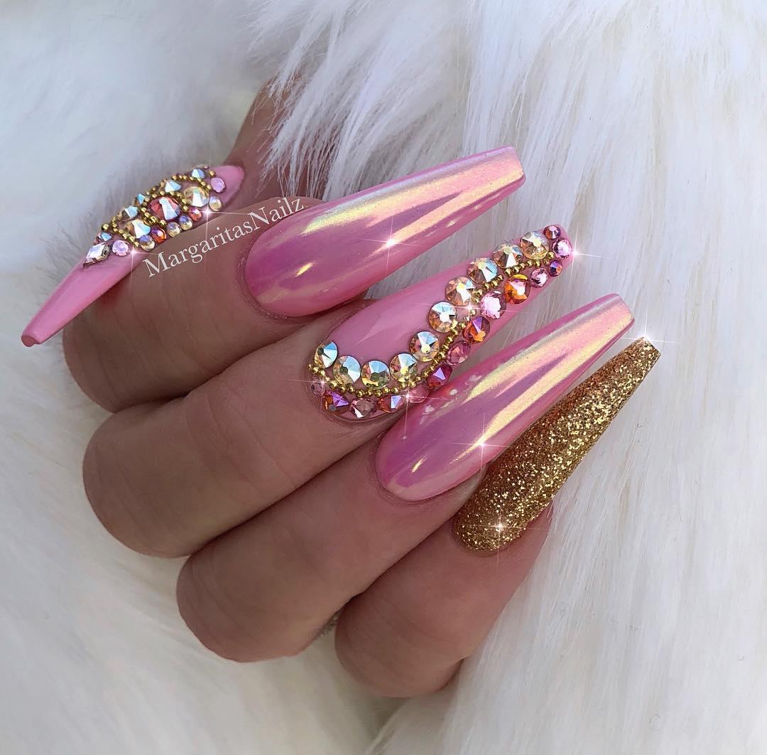 Highly embellished pink chrome nails