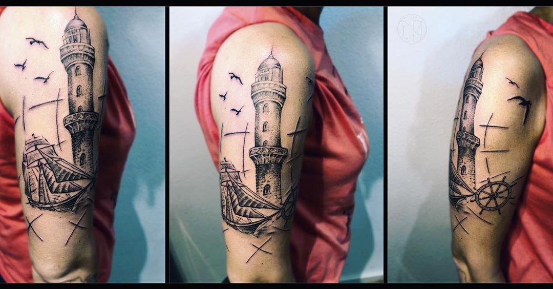 Upper Arm Lighthouse Tattoo