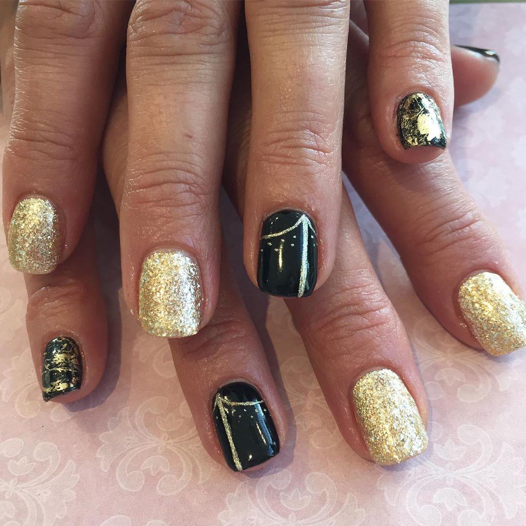 Dazzling Gold & Black Nail Designs