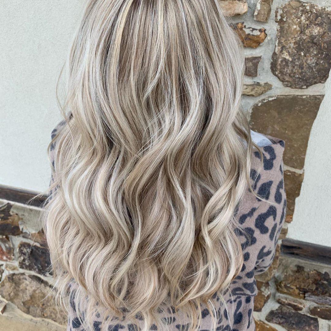 Brown Lowlights with big wavy blonde hair