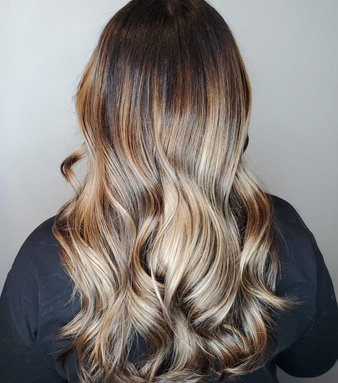 Deep brown lowlights to blonde hair