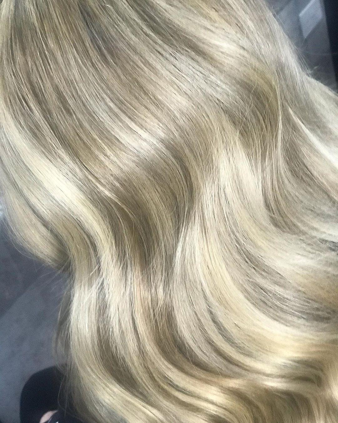 Wavy blonde hair with brown lowlights