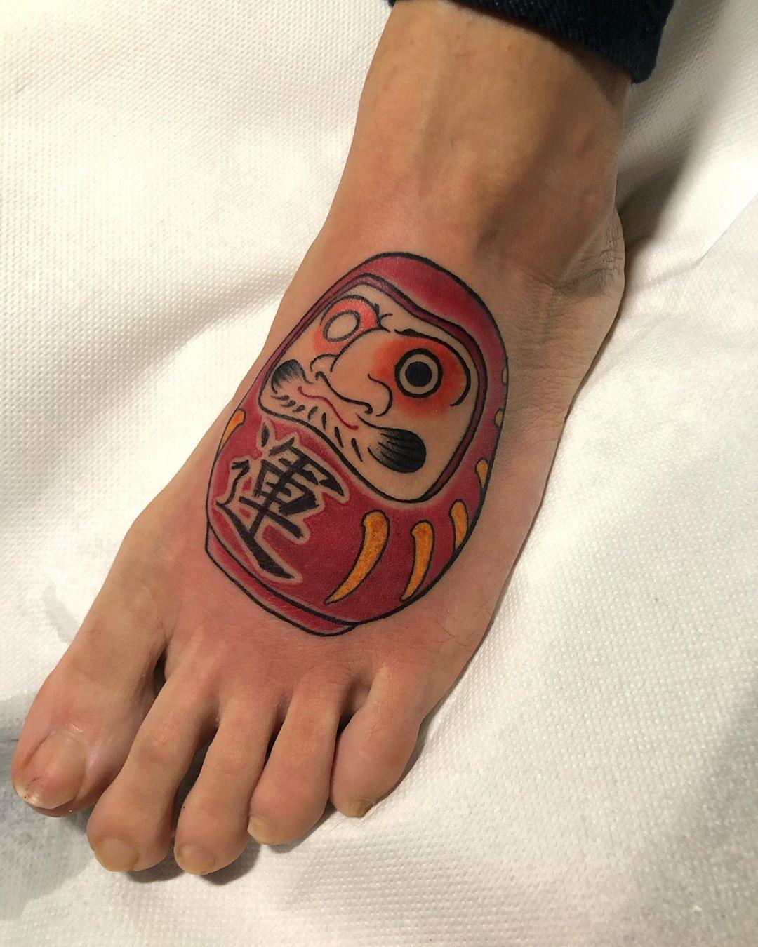Daruma Doll foot tattoo