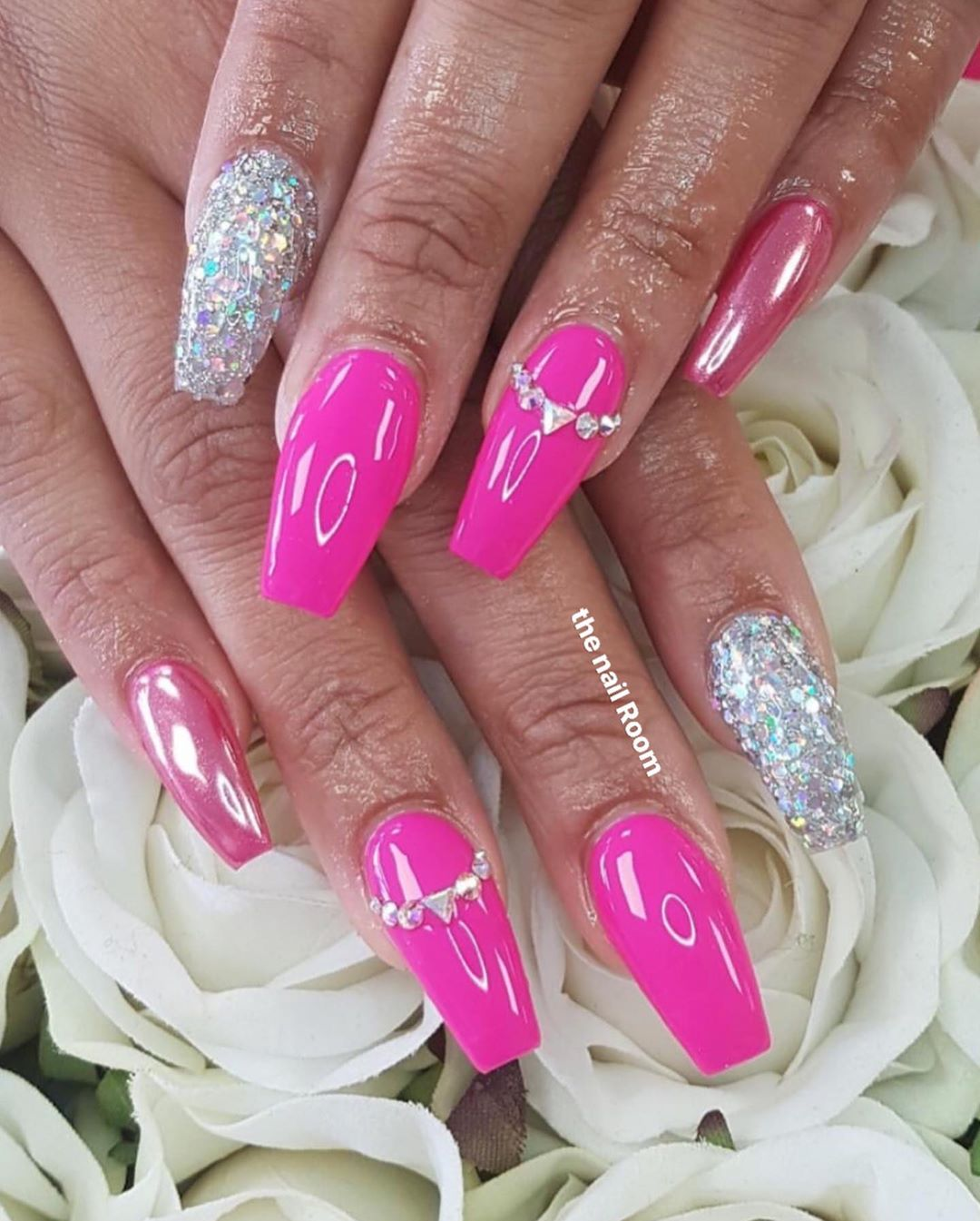 Dazzling hot pink chrome nails