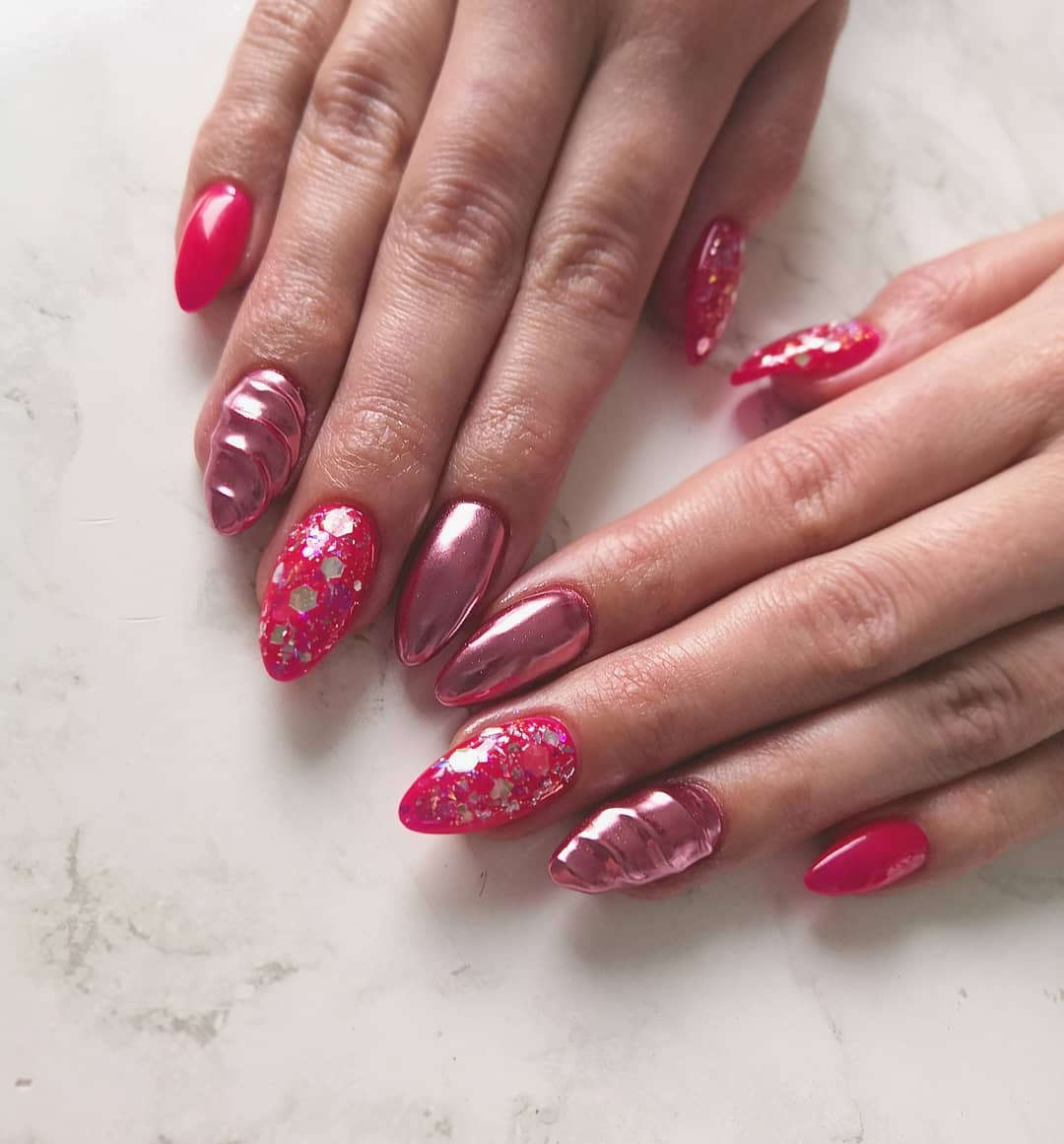 Layered and textured pink chrome nails