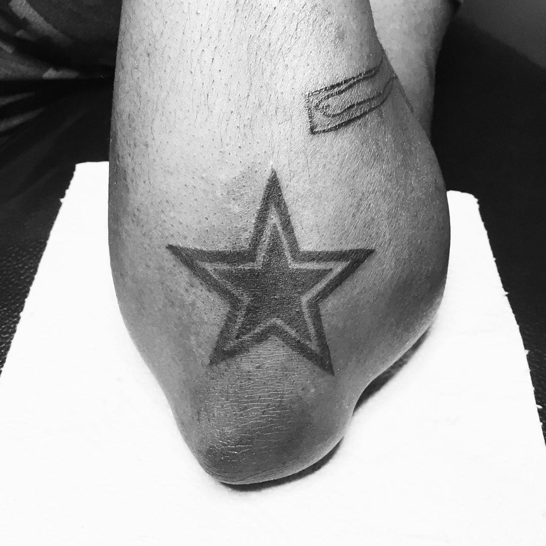 Dallas Cowboy Star Tattoo on Elbow