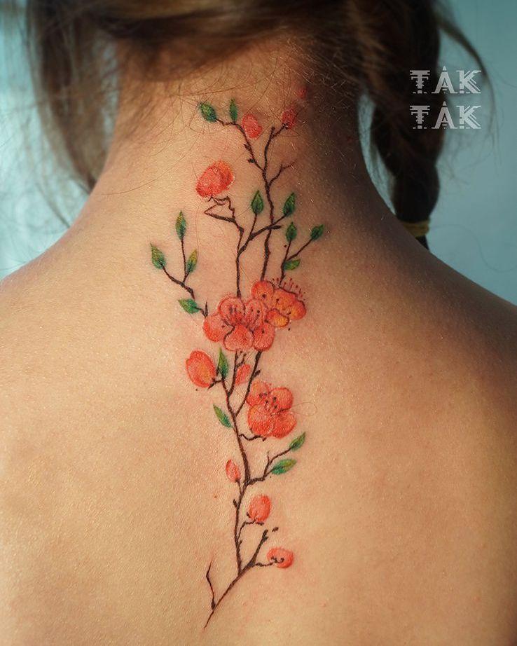 Japanese Sakura tattoo down the neck onto the back