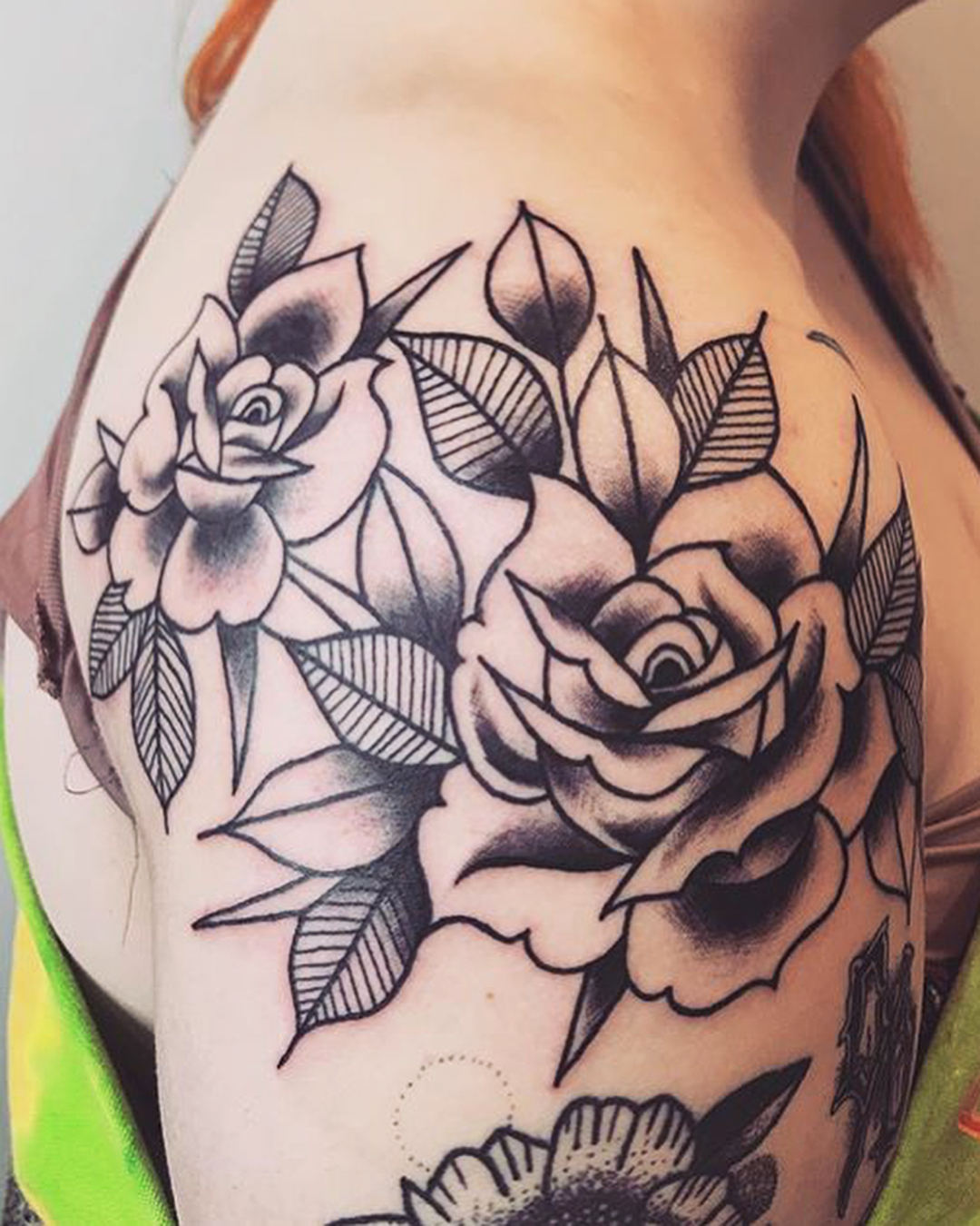 Detailed rose shoulder tattoo