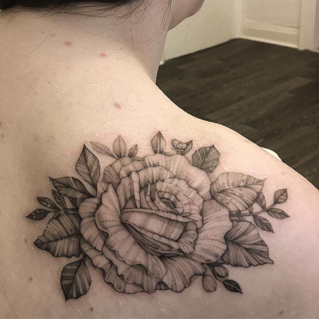 Small detailed Image of rose shoulder tattoo