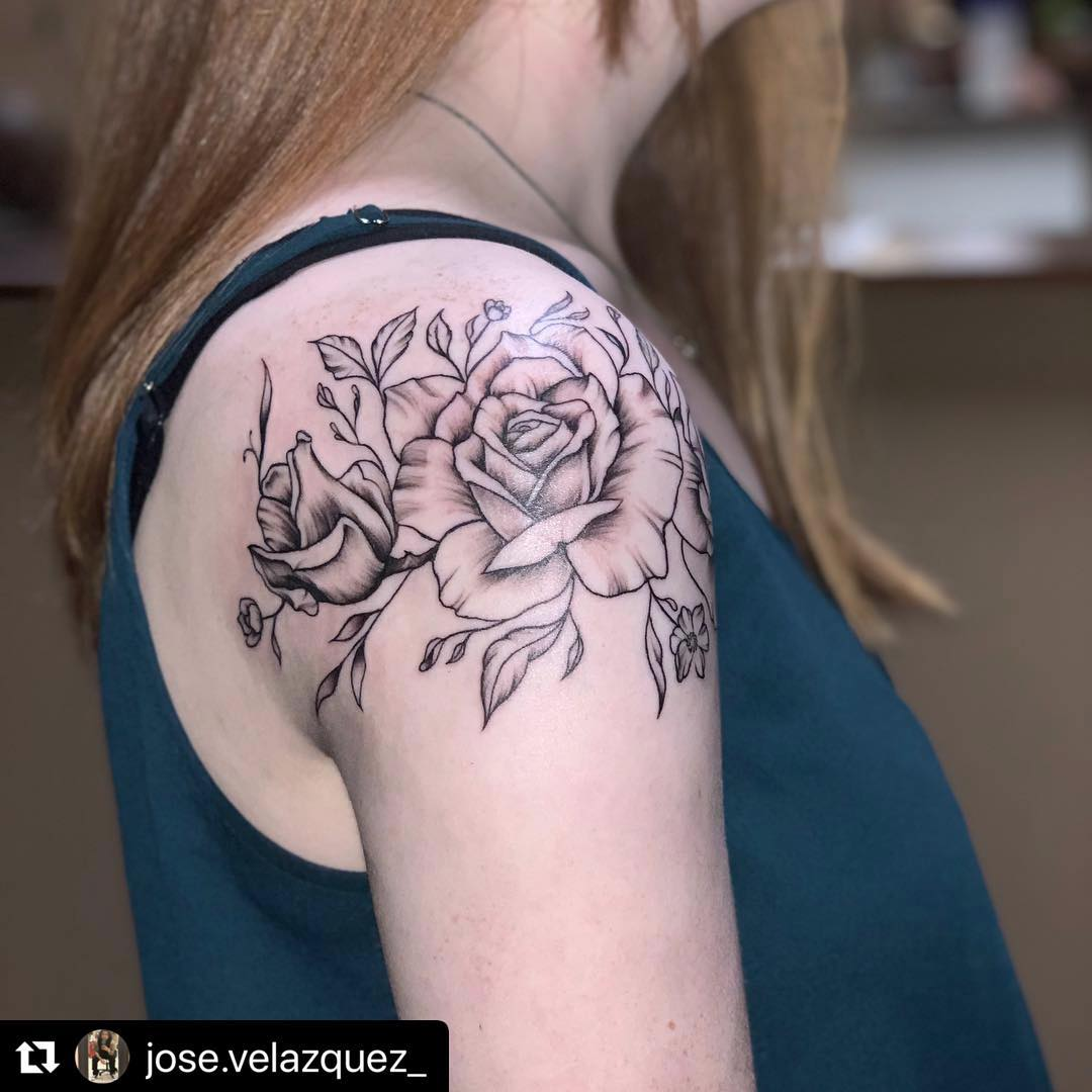 Image of rose shoulder tattoo in black and white