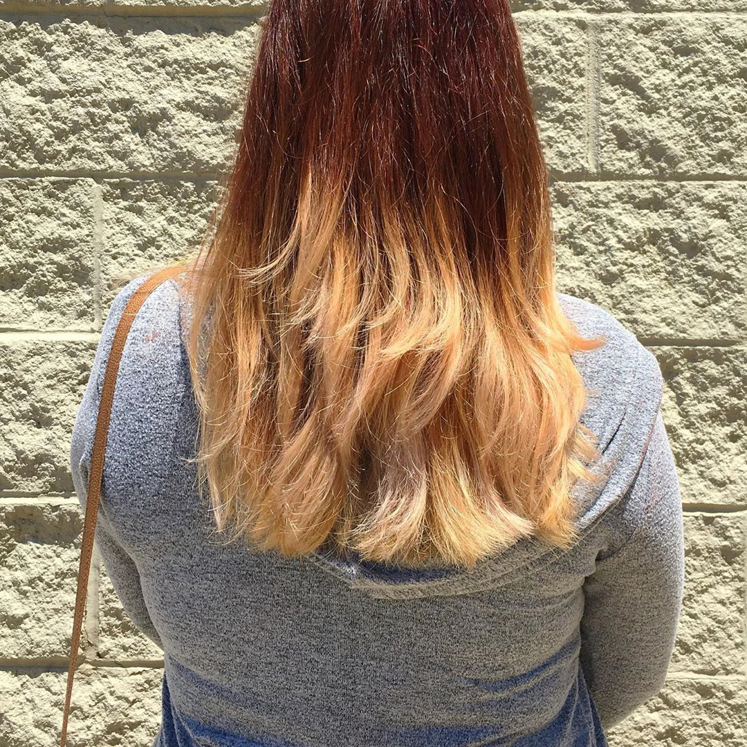 Image of a red to blonde ombre hairstyle