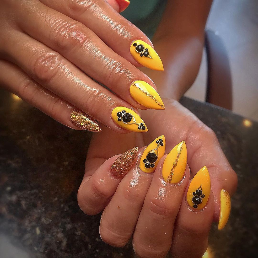 Yellow Acrylic Nails with Black Diamons