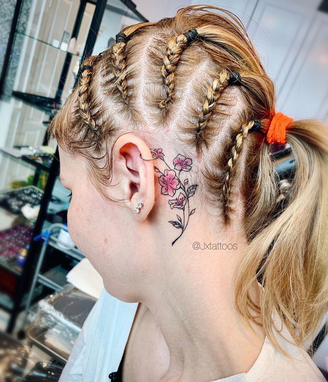 Japanese Sakura tattoo behind the ear
