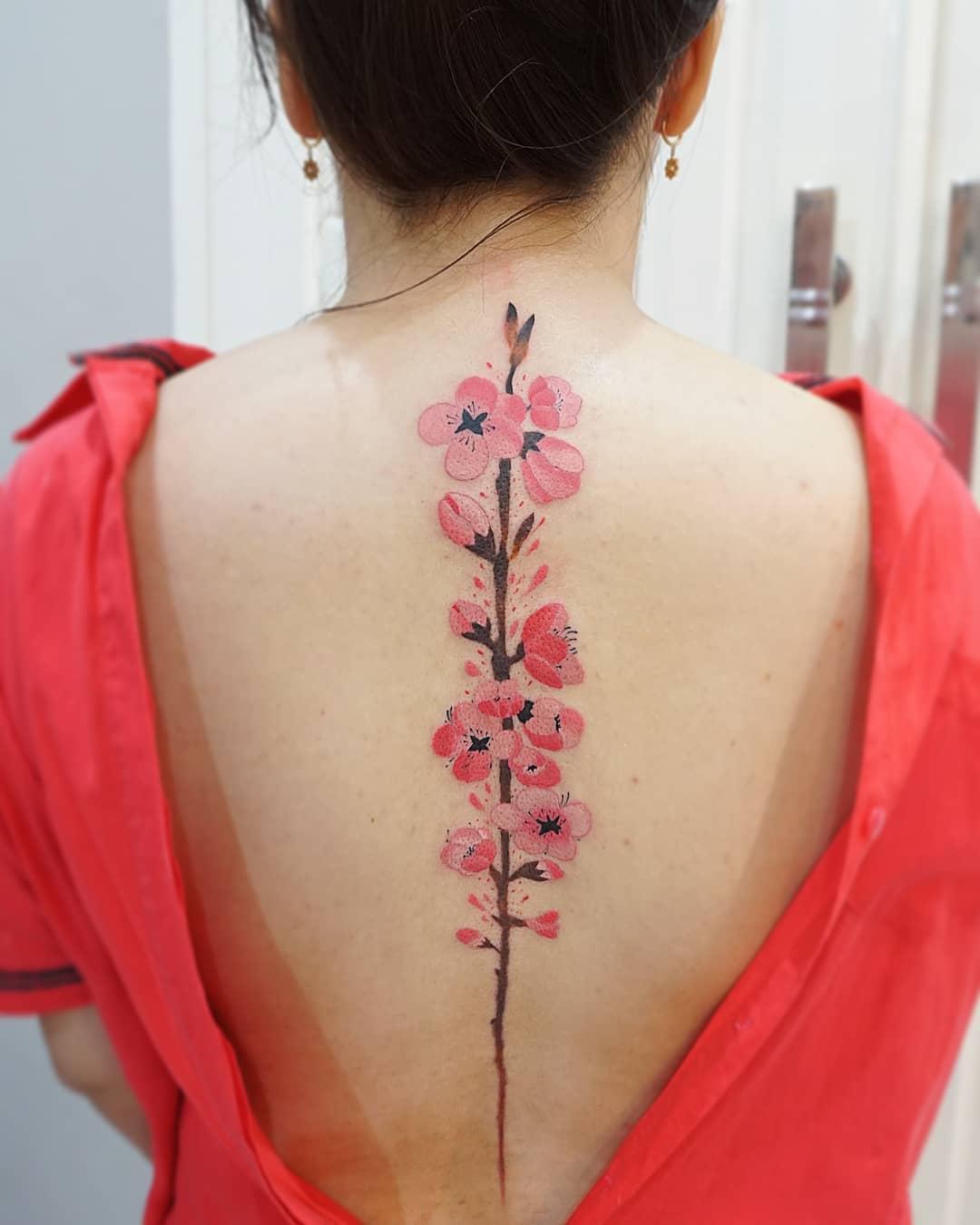Pink Japanese Sakura tattoo on back