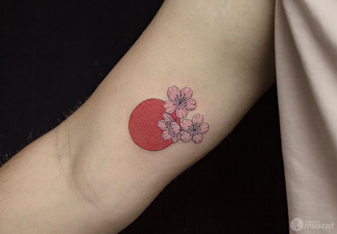 Japanese cherry blossom tattoo with flag