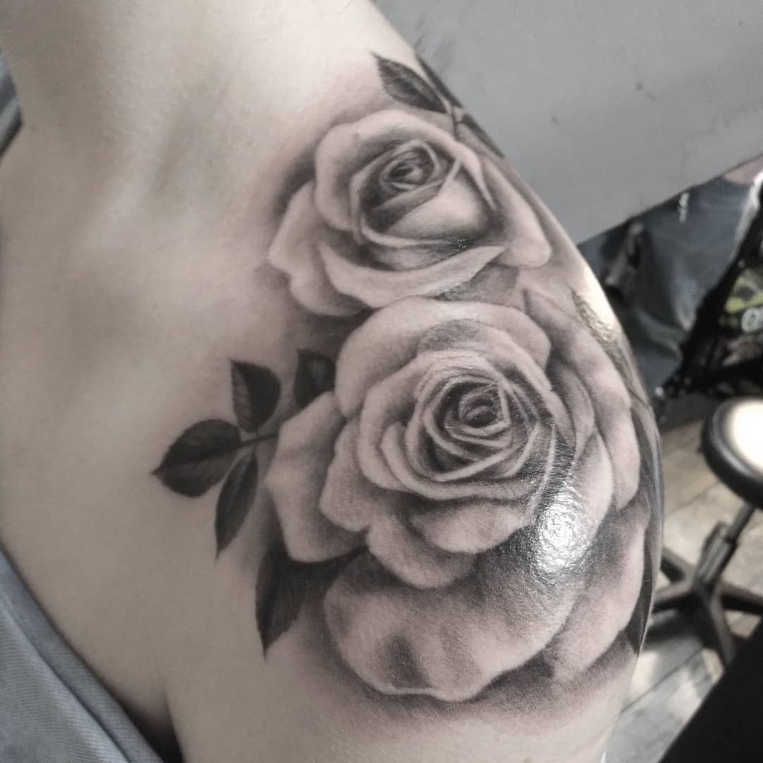 Faint Image of rose shoulder tattoo