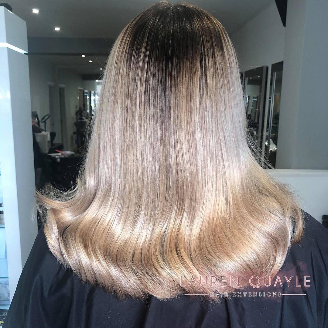 Image of dark roots on a blonde hair style