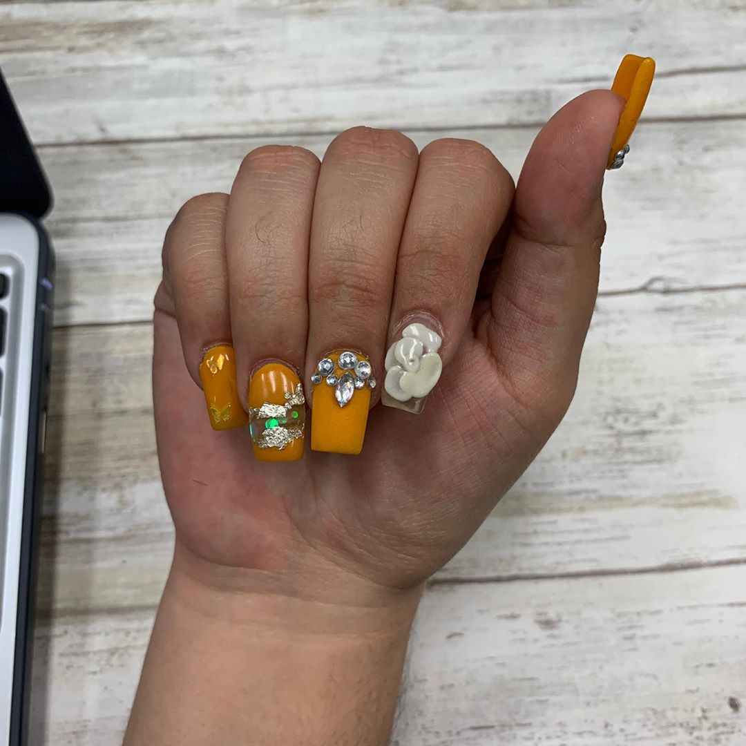 3d Effects on Yellow Acrylic Nails