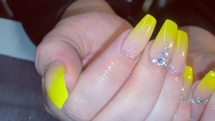 Bright diamonds on Yellow Acrylic Nails