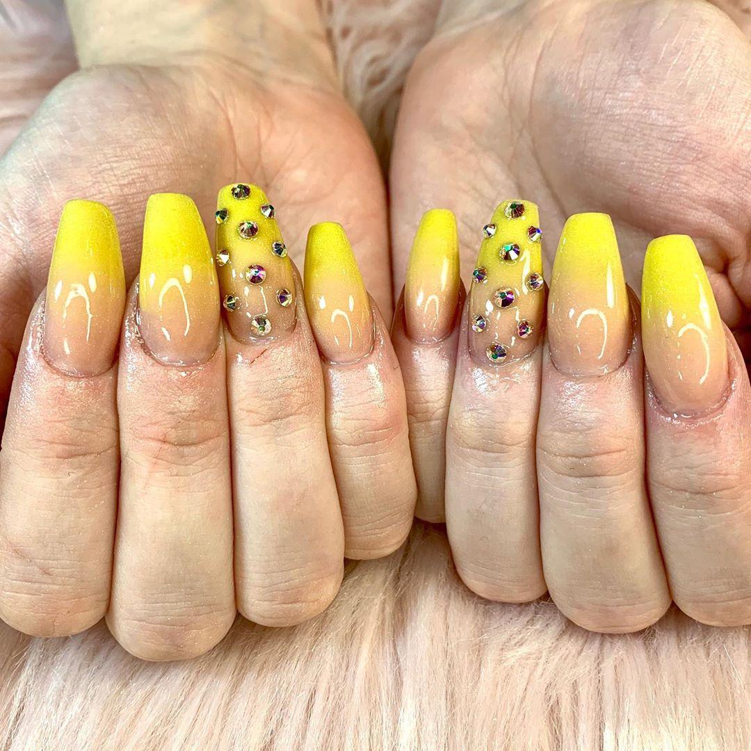 Rhinestone embellishments on Yellow Acrylic Nails