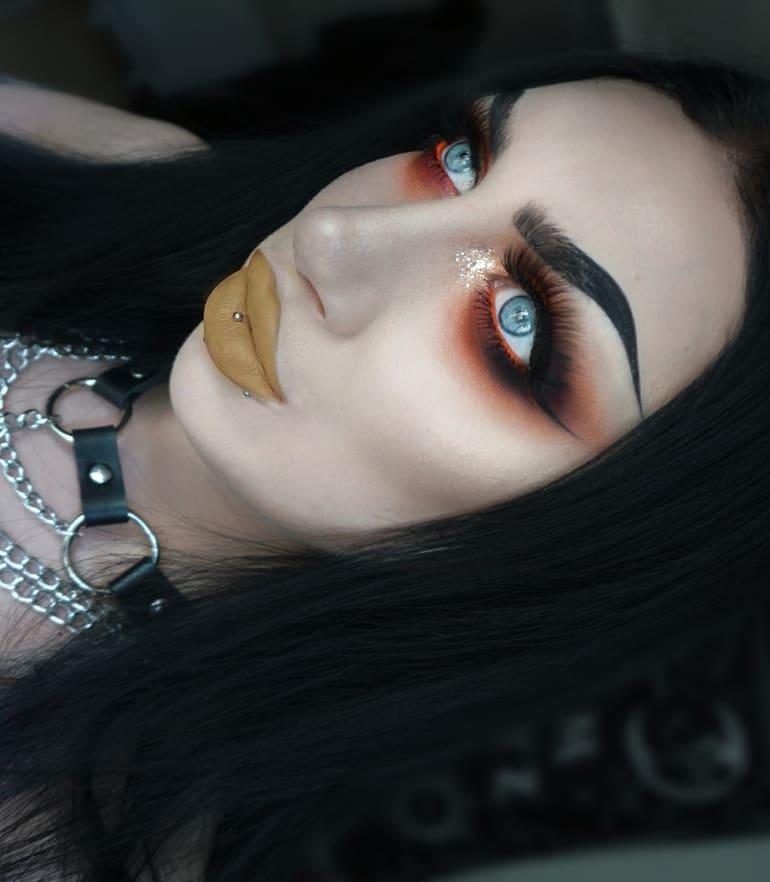 Winged eyeliner on ultra gothic look