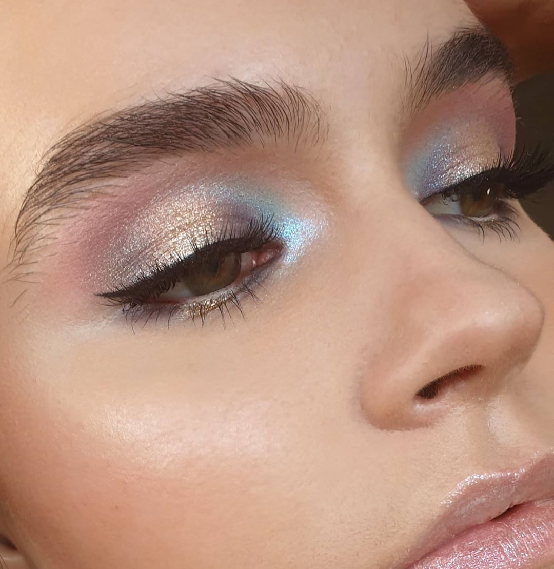 Shimmery disco dust and winged eyeliner