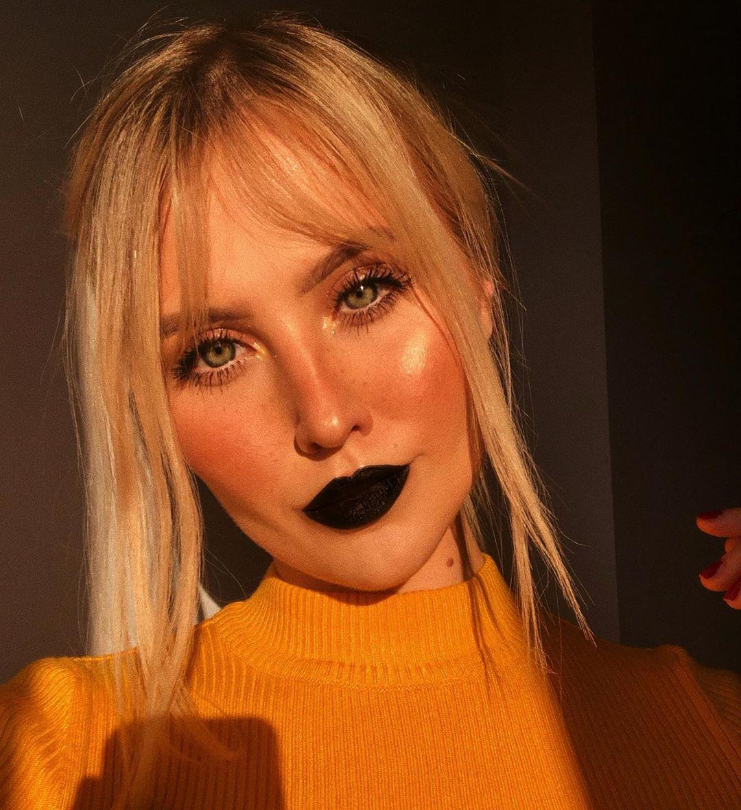 Faux Freckles Makeup technique with black lipstick