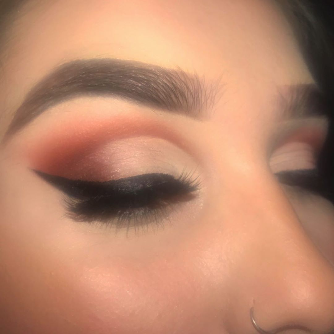 Sweeping winged eyeliner ombre