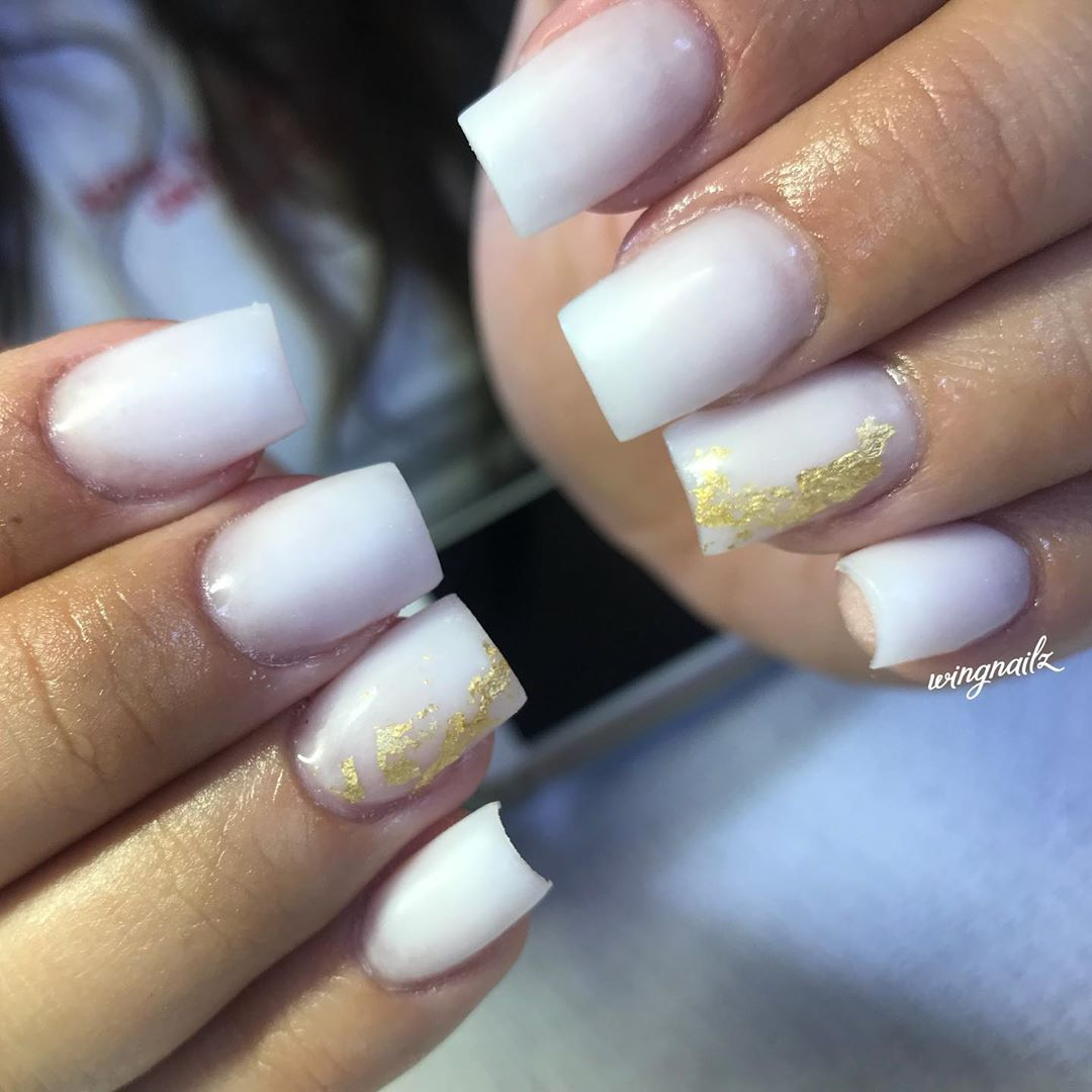 Beautiful example of milky white nails trend