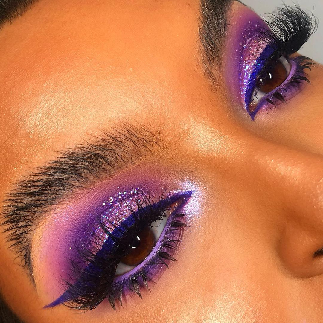 Purple eyeshadow with winged eyeliner