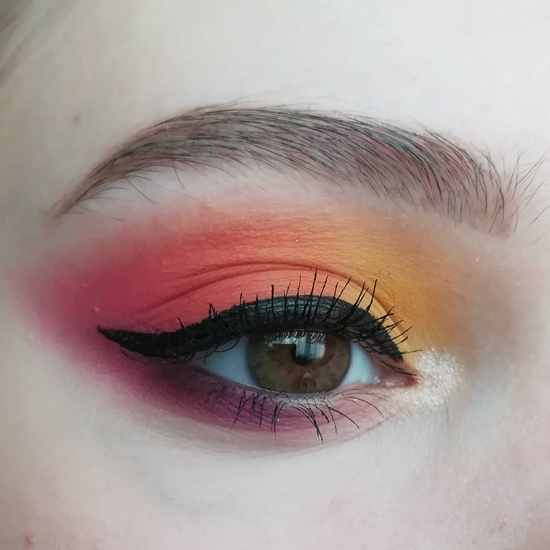 Up close image of colorful winged eyeliner