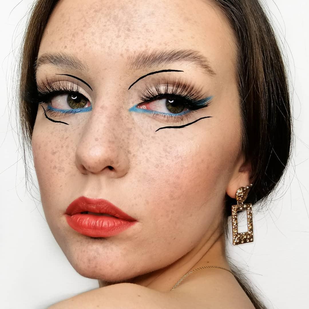 Black Streaks, Blue Eyeliner and Faux Freckles Look