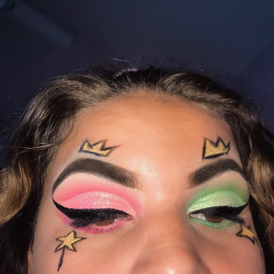 Green and pink eyeshadow with winged liner