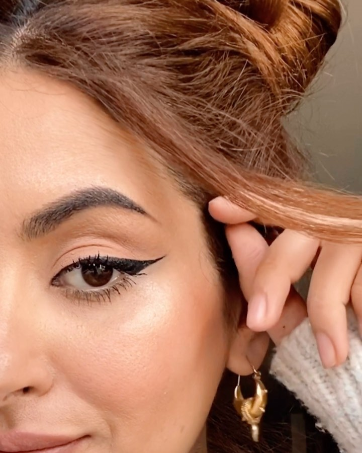 Asymmetrical winged eyeliner image