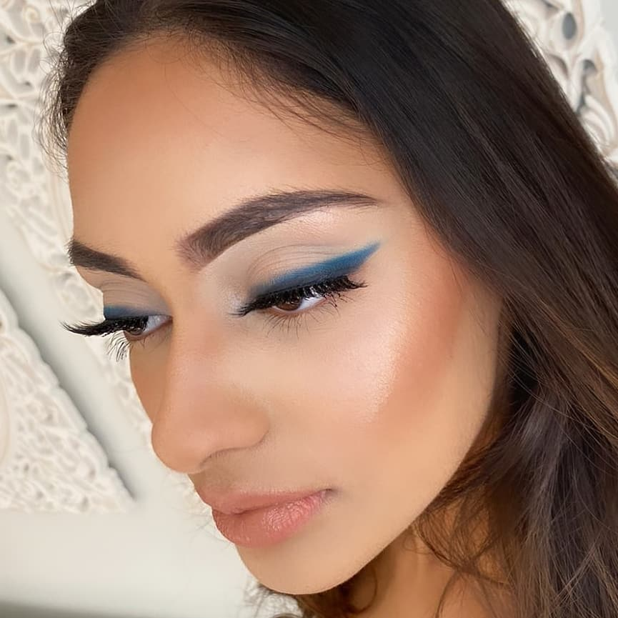 Blue eyeshadow with wing shape