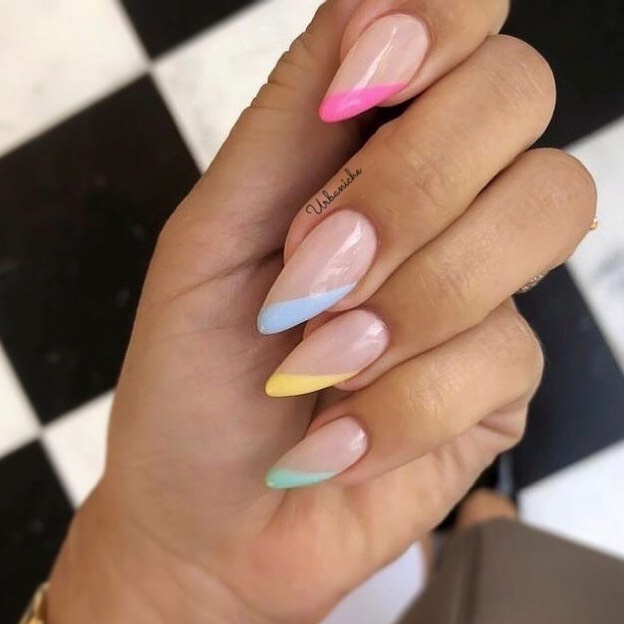 Beautiful image of colored french tips to inspire your next nail look.