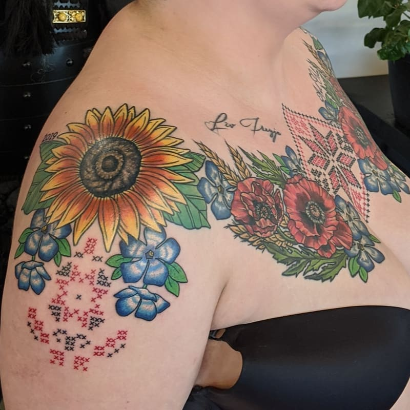 Image of cross stitch tattoo