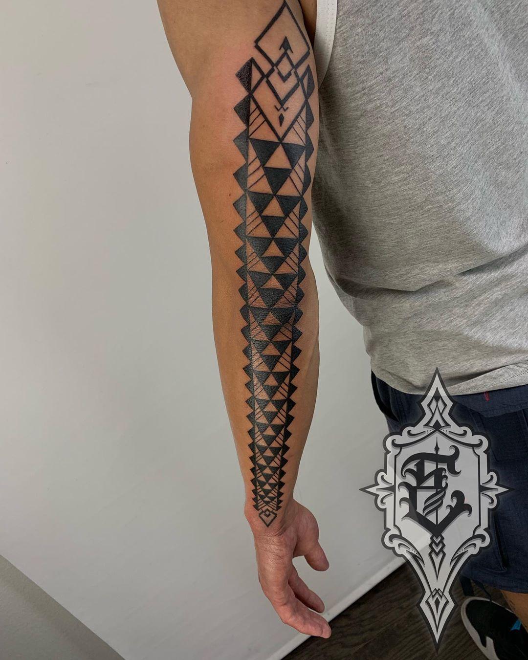 Spears in Hawaiian tattoo