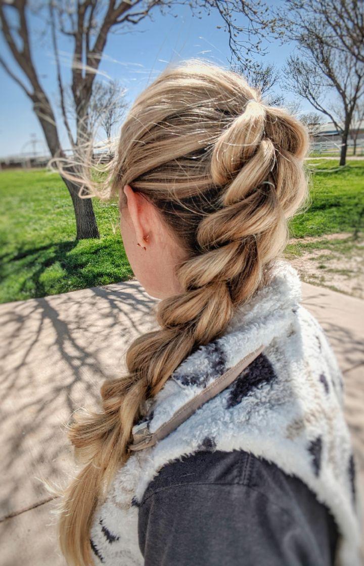 Pull-through braided ponytail on long blonde hair