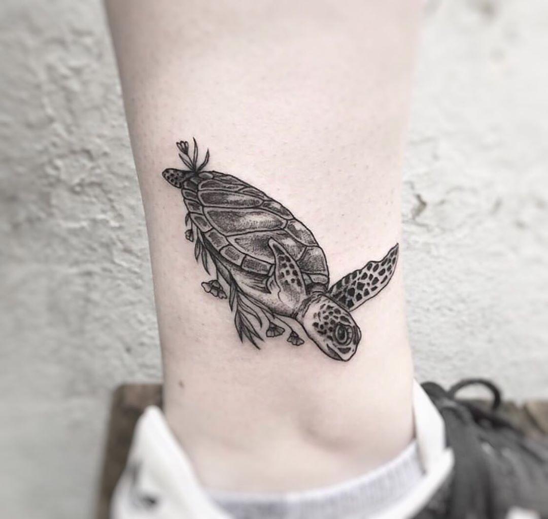 Swimming sea turtle tattoo