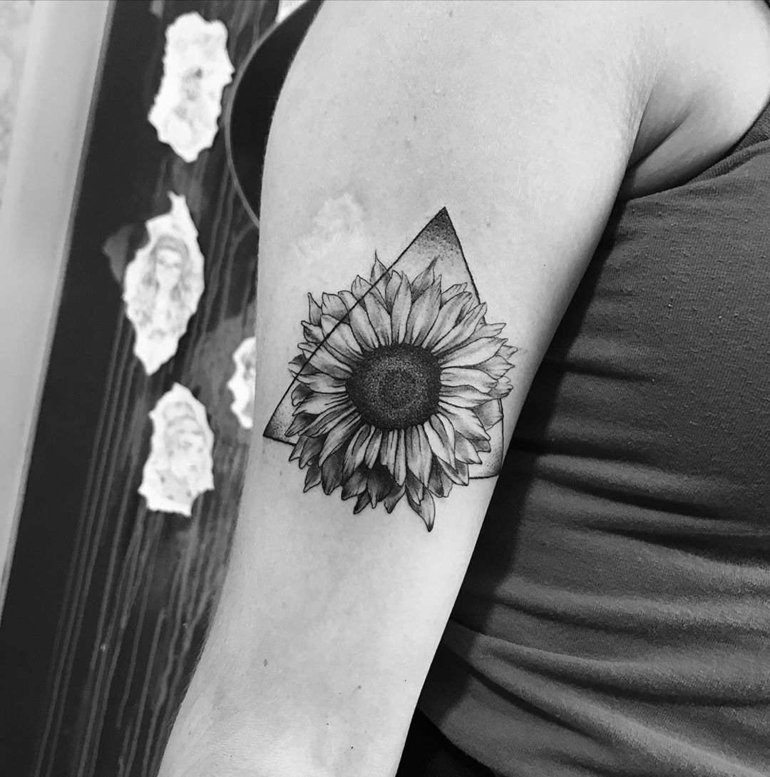 Beautiful image of a small sunflower tattoo