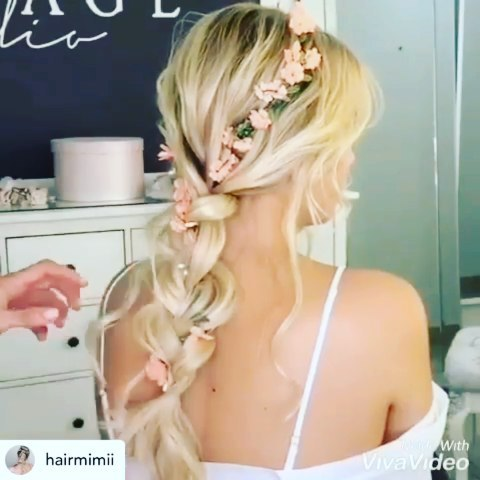 Weaving flowering in a Boho braids hairstyle