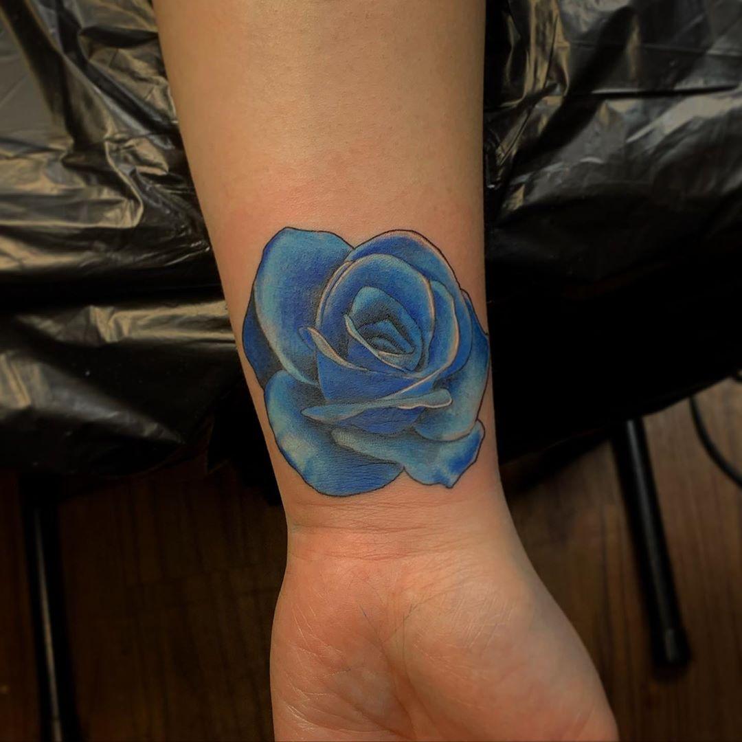 Blue rose Hawaiian tattoo