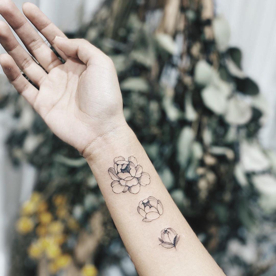 Wrist peony tattoo design