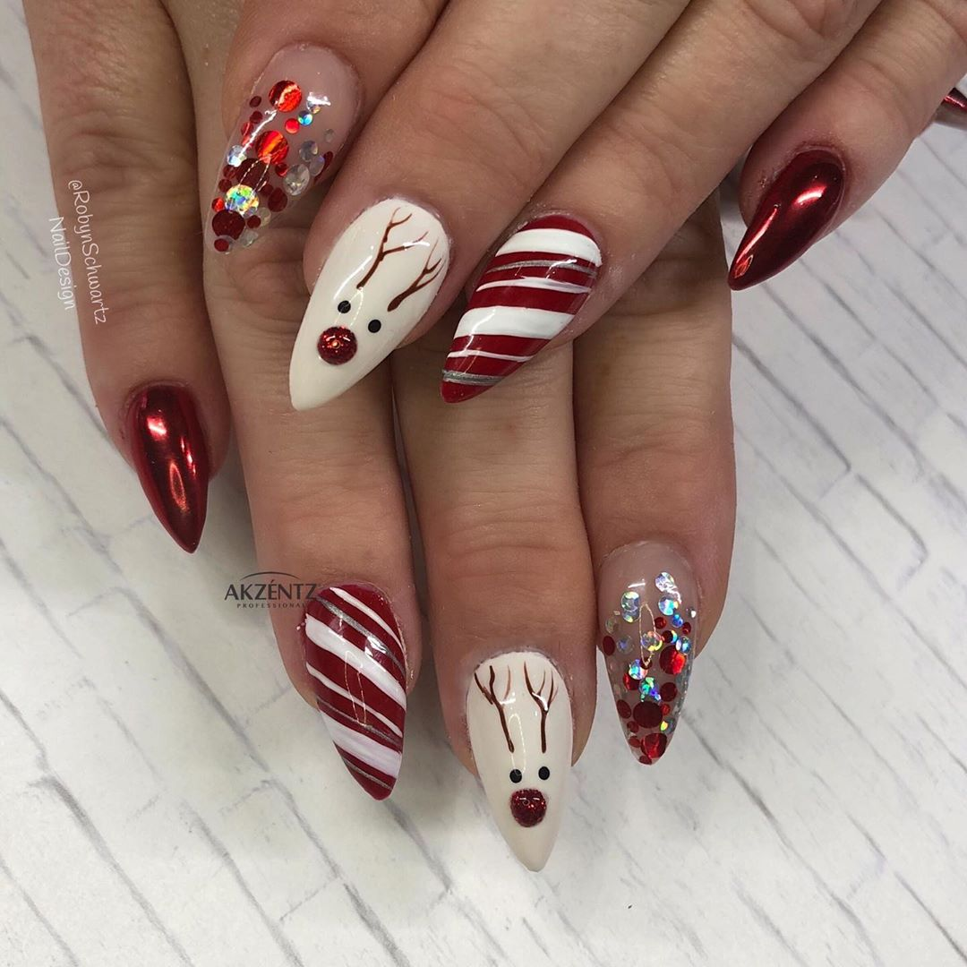 Peppermint candy cane twist combined with reindeer on Stiletto Christmas Nails