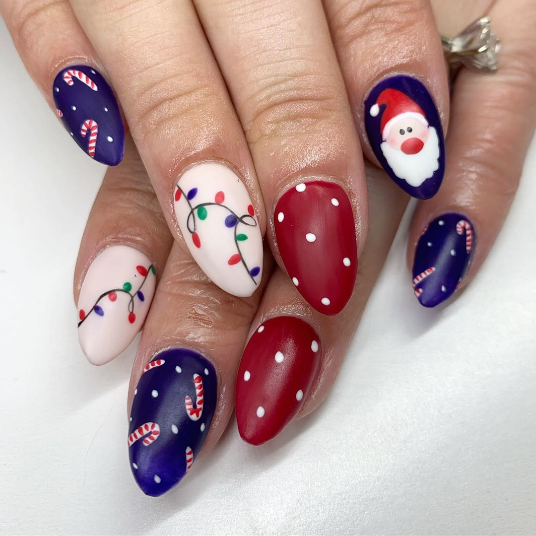 Red, white and blue Christmas nails, including light bulbs and Santa Clause